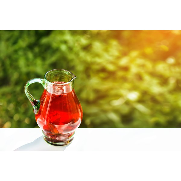 A pitcher of cranberry juice.