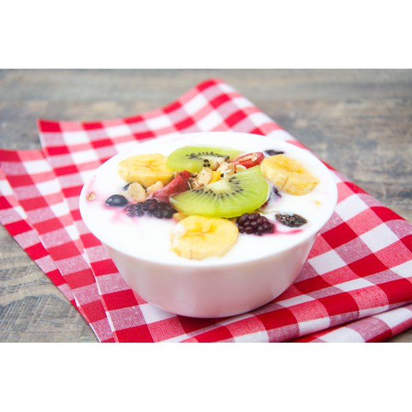 A large bowl of yogurt topped with fresh fruit.