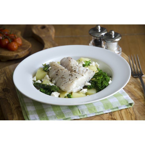 Seasoned baked haddock with green vegetables, new potatoes, fresh herbs and feta cheese.