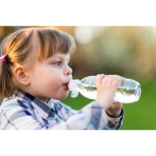 Have your child take a sip of water before trying to swallow any pills.