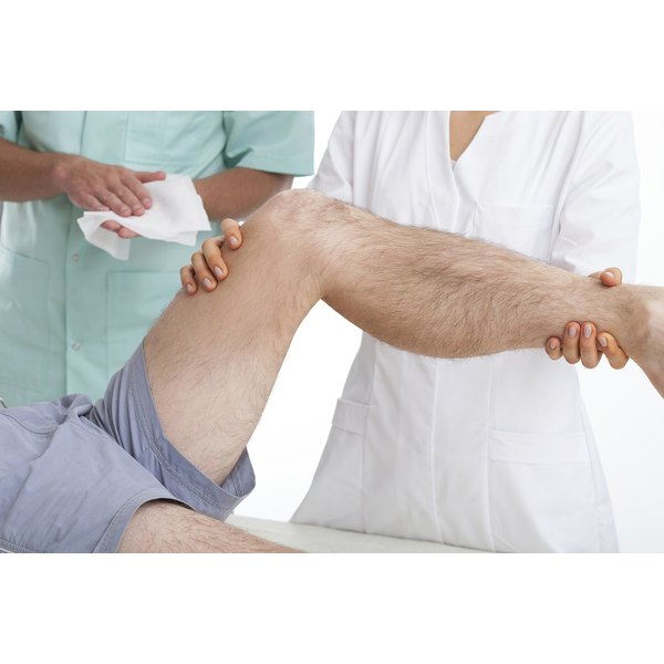 Therapist working on a man's leg