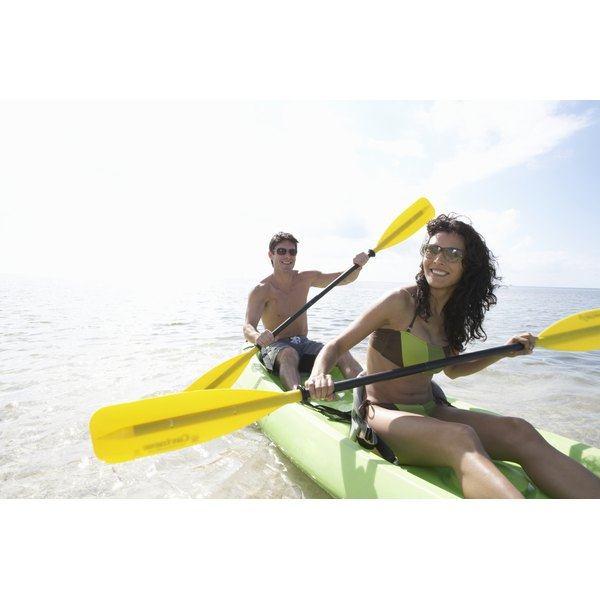 A man and woman are in a kayak.