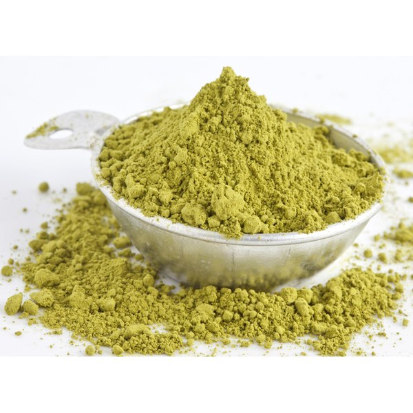 Green powder in a scoop