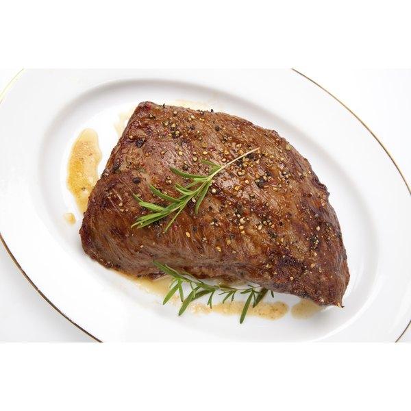 A roast sirloin tip on a plate.