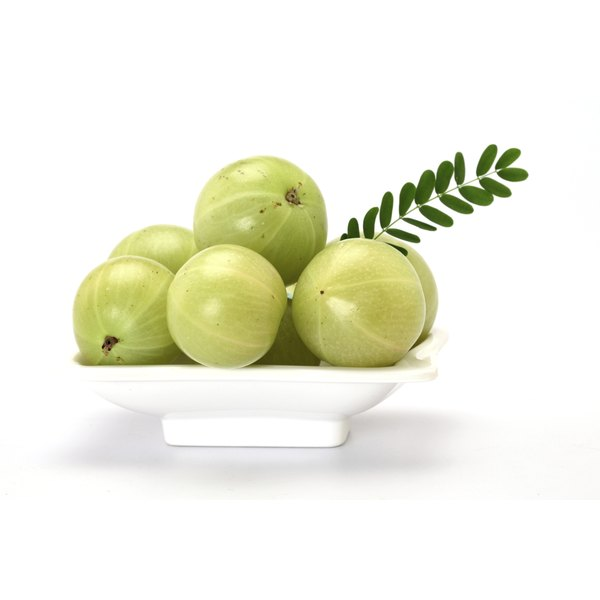 Amla, or gooseberries, are globe-shaped and pale green.