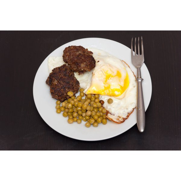 A plate of eggs, meat, and peas. Foods like meat and eggs are good sources of Taurine, which is good for those with ADHD.