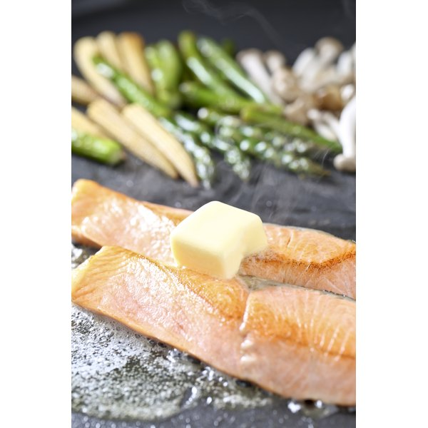 Frying salmon in butter.