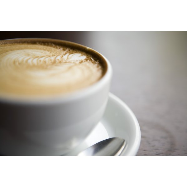 Close-up of cafe in coffee cup