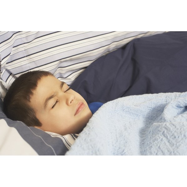 Boy sleeping in bed.
