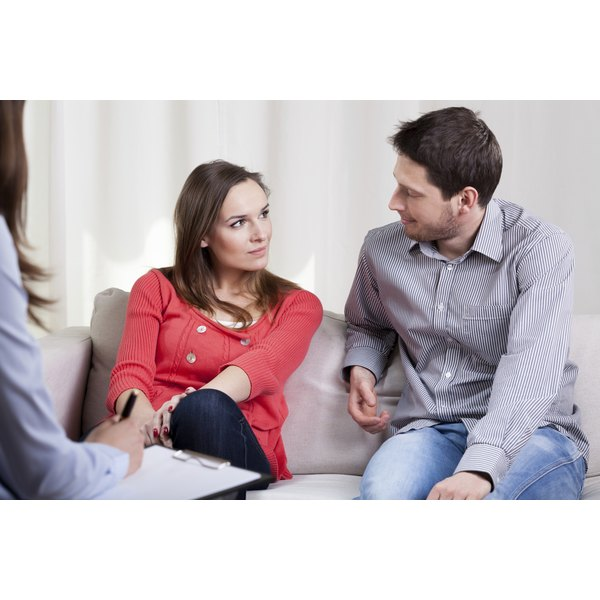A couple talking during a marriage counseling session.
