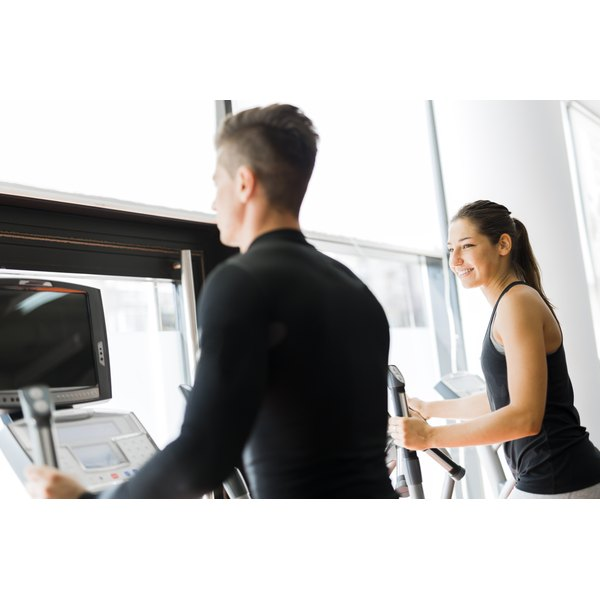 Man and woman on an elliptical machine
