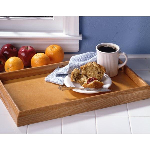 An apple bran muffin on a breakfast tray.