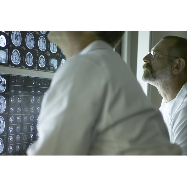 Two doctors analyzing brain scans.