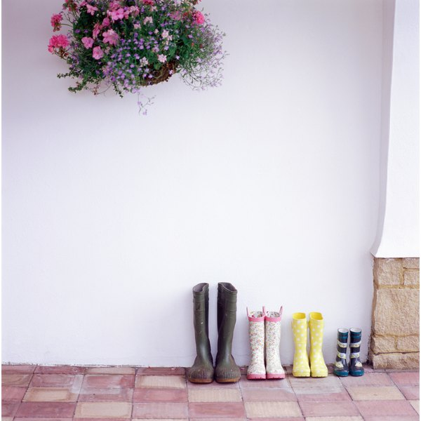 Leaving rubber boots that smell like gasoline outside may help them to air out.