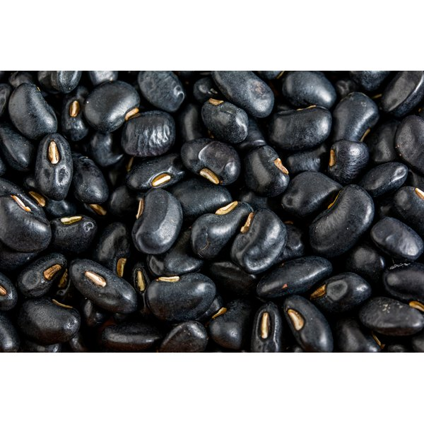 A close-up of dried black beans.