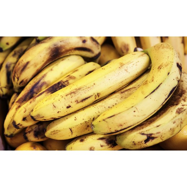 A close-up of ripe bananas for sale at a market.