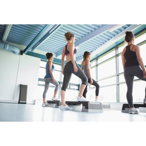 Women are exercising in a gym studio.
