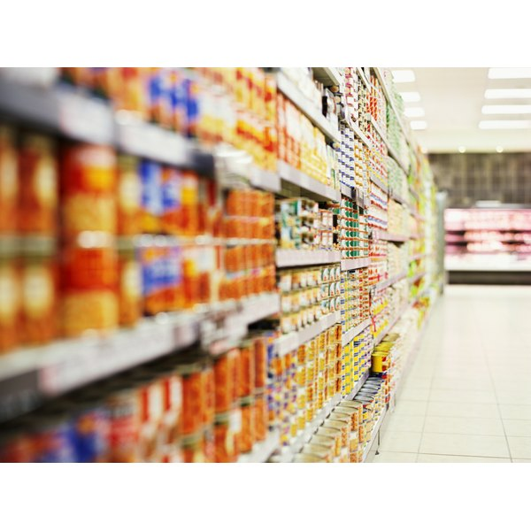 Supermarket shelves are filled with processed foods.