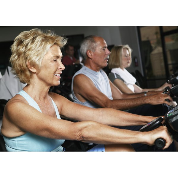 Mature adults exercising in a gym.