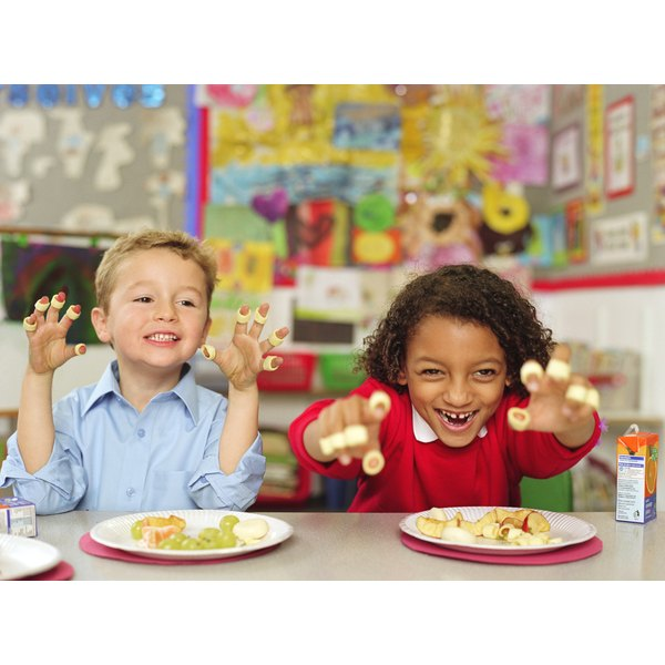 Two students having a snack in the classroom.