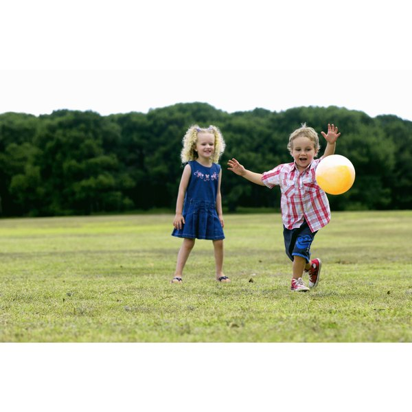 Two children running outside.