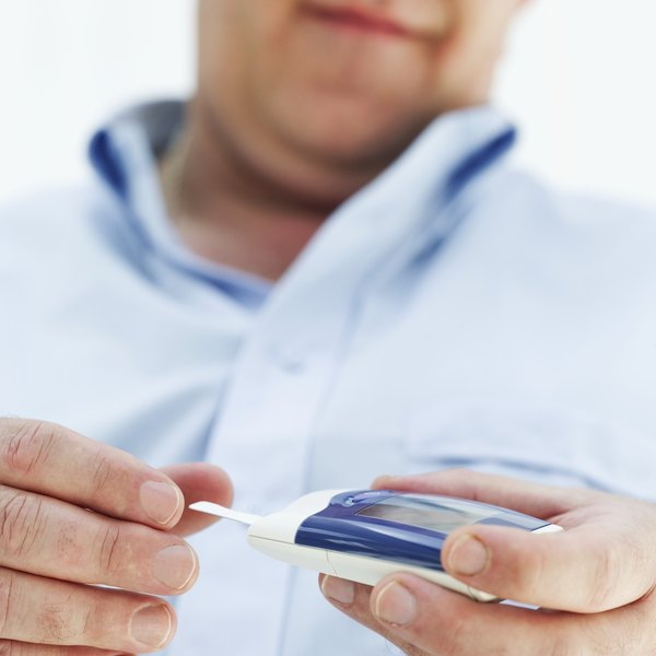 A man tests his blood sugar levels.