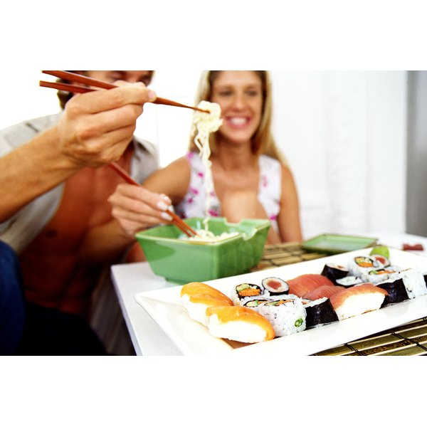 A couple eating with chopsticks