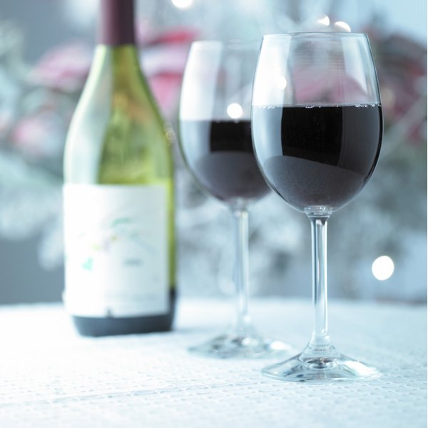 Bottle and glasses filled with red wine