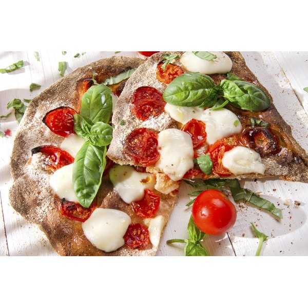 A nutritious margarita pizza with a whole-wheat crust and fresh mozzerella.