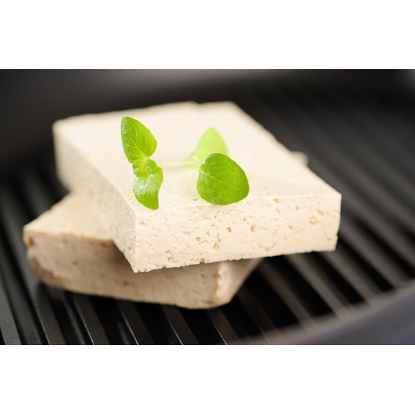 Two blocks of tofu are sitting on top of a skillet.