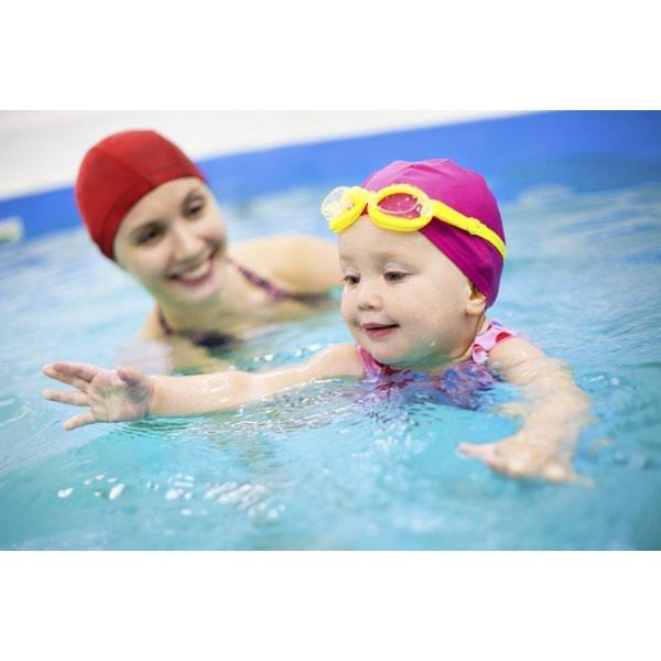 Mother and daughter during swimming lessons