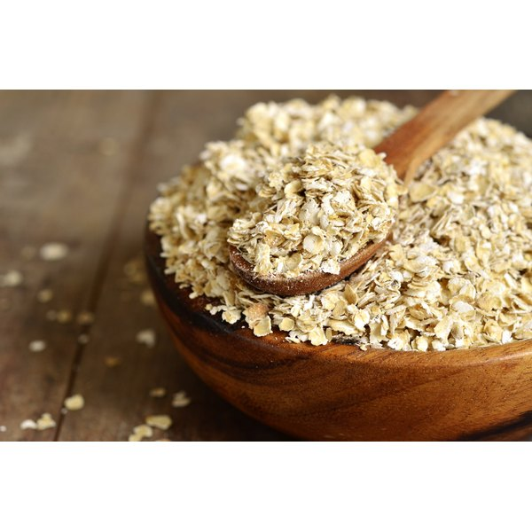 A bowl of whole grain rolled oats.