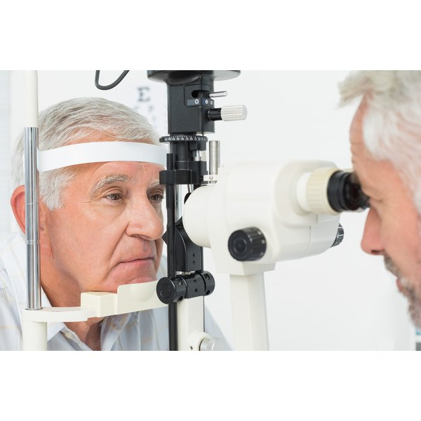 A man is having his eyes examined.