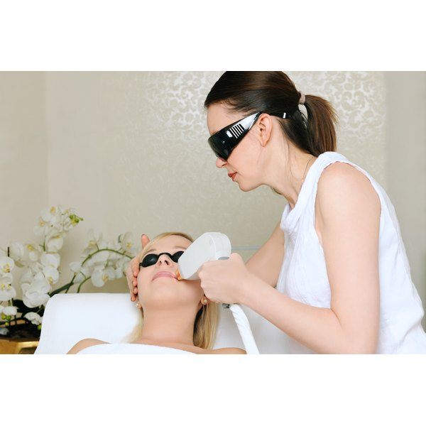 A woman is undergoing laser hair removal treatment.
