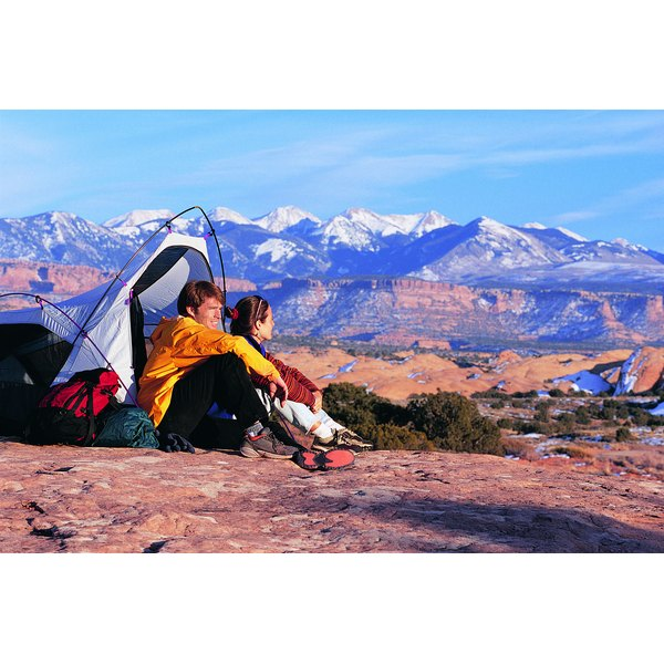 A couple enjoys the view from their campsite.