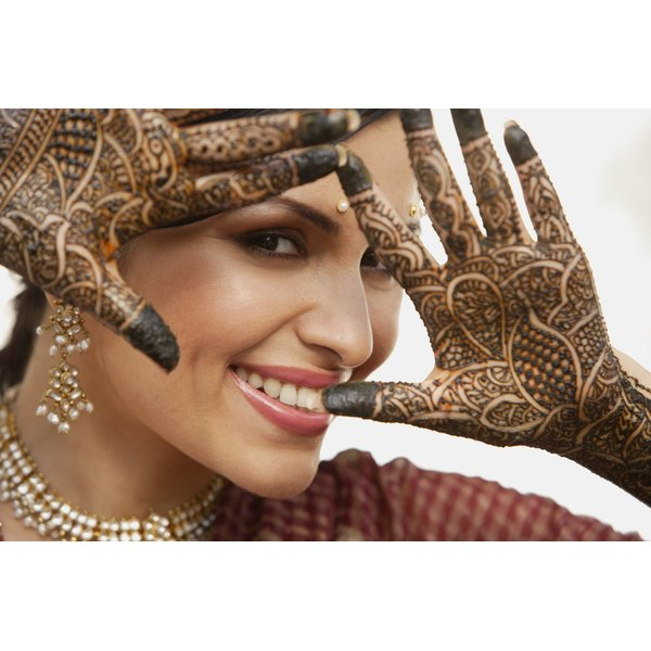 Brides in India paint their hands with henna designs for good luck.
