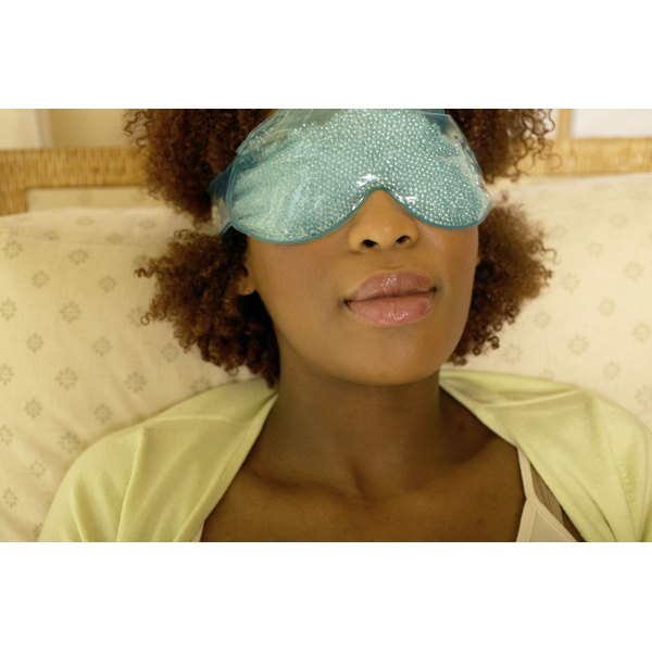 A woman is wearing a sleep mask.