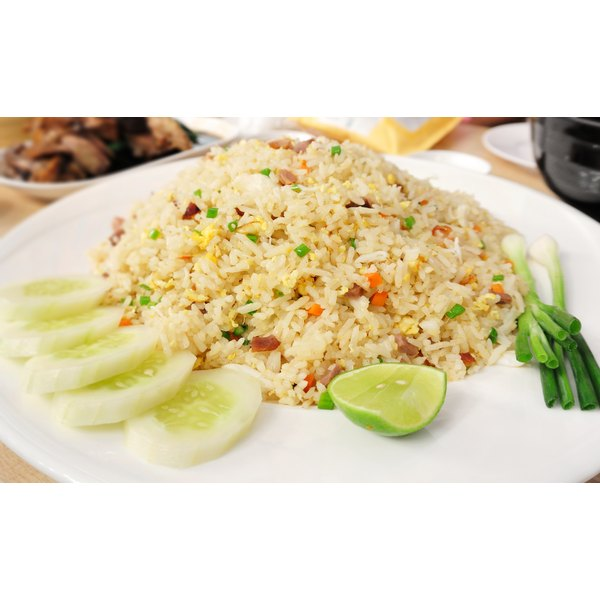 A large plate of pork fried rice.