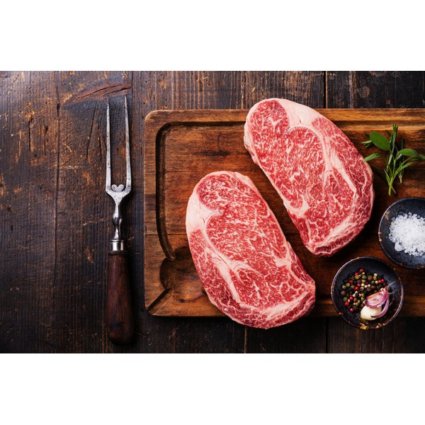 Raw beef on a cutting board.