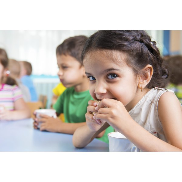 Young child eating at daycare