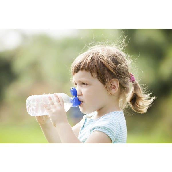 Carrying a water bottle helps adolescents remember to drink enough fluids.
