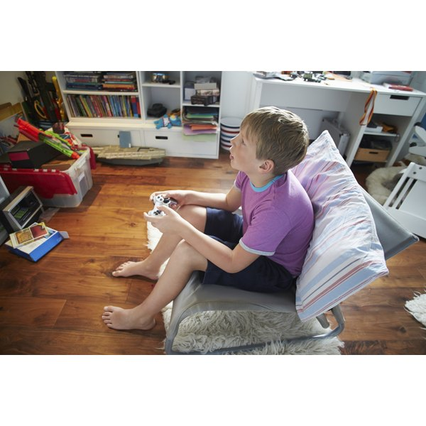 Boy playing video game in his bedroom