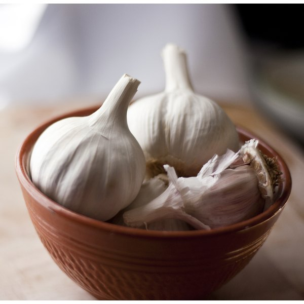 A bowl of garlic on a kitchen counter.