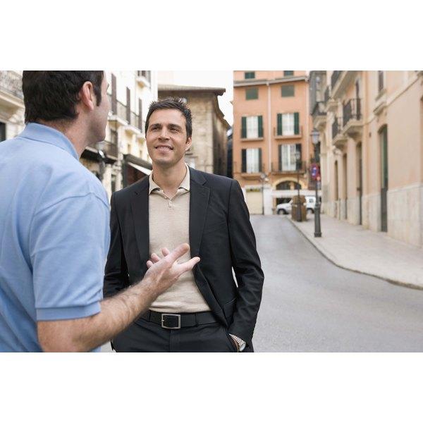 Friends talking in street
