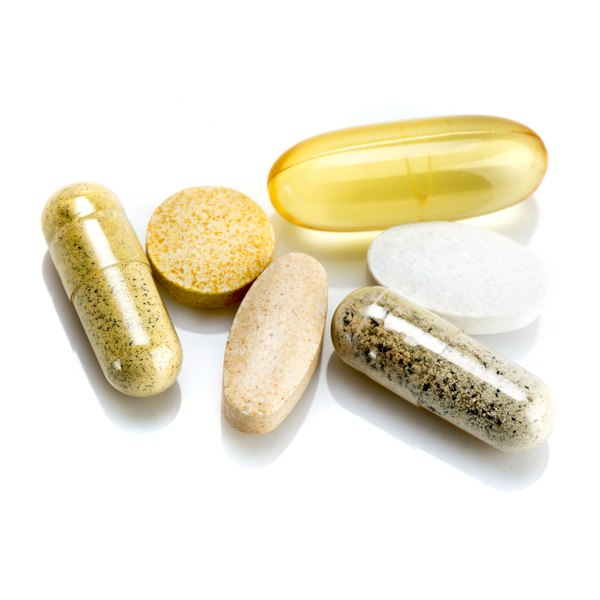 A group of different herbal supplement pills.