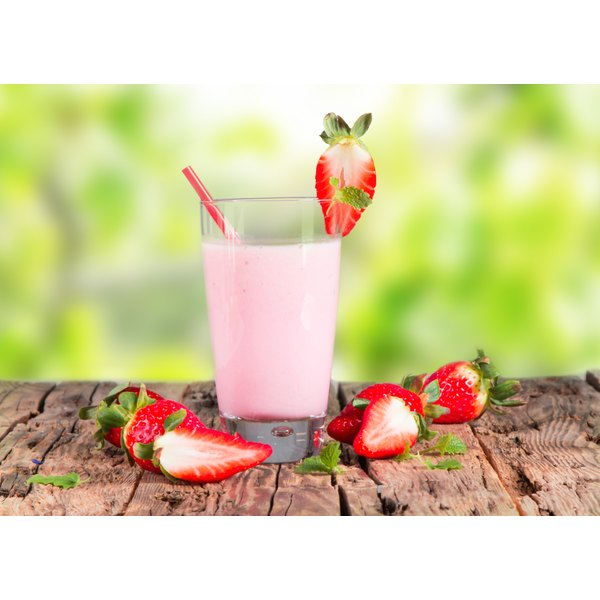 A strawberry whey protein drink on a table.