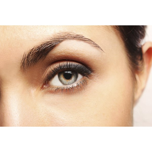 Apply a cold compress to constrict blood vessels and lessen darkness under the eyes.