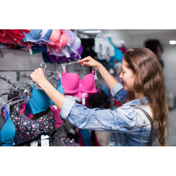 A young teen is shopping for a bra.