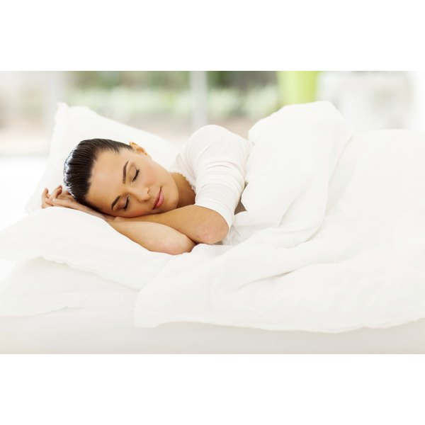 woman sleeping peacefully on mattress