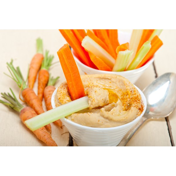 Dip vegetables in hummus instead of snacking on less-nutritious, acid-forming foods.